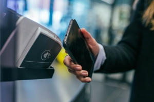 Why does the U.S. trail Asia in mobile payments adoption?