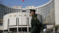 What are the implications of China's push towards its own digital currency?
